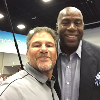Tom with former NBA player Magic Johnson